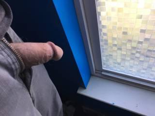 Peeping out the window wishing my neighbor was out in her bikini