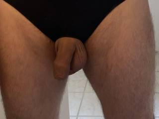 Here's a pic of my flaccid uncut cock in my black crotchless briefs.