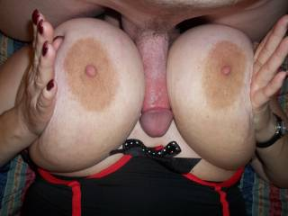 Huge tits and cock in between. Love it. Great tits girl.