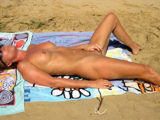 The warm sun caressing my body often makes me want to caress my pussy while relaxing on the beach...