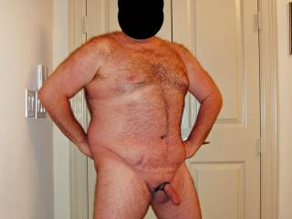 I had hubby pose with his cock and balls snug in his cock rings.