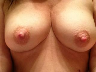 love to suck and lick your big sexy nipples, love to see some pics of your lovely pussy if you have them