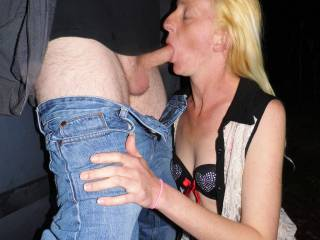 What a nice gal she is. She looks gorgeous with the big cock of a stranger inside her mouth. Such a treat to feel her pleasing mouth servicing a cock like that in the open. She would have offer herself to him to let him fuck her with out conditions.