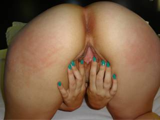 Gretchen\'s round phat ass as she spreads her pussy. As her red glowing spanks marks are there for all to see!