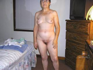 Here is another shot of her nude body around the house