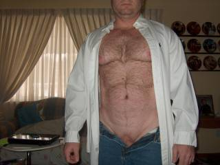 I love a man with his chest exposed so I can play with his hairy chest and in jeans with his cock begging to be free