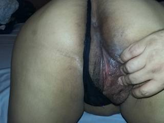 Spreading her pussy with black painties on