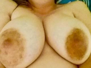 My friends wife has massive tits.