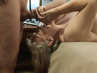 Every woman needs a good face fuck. Mrs. Shutterbug58 loves cock in this position. Listen how she sucks and licks that cock.