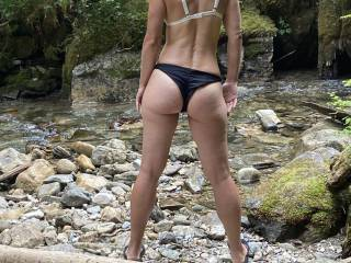 She sure turns heads and makes them hard when she teases at the beach!! She always loves to see just how much they check her out! Just makes a guy want to spank that ass!!