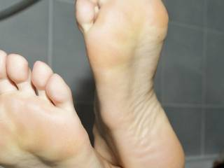 I fantasize about holding her ankle so she can't get away and slowly tickling her foot to the point where she begs me to stop. She agrees to suck my dick so I pop it in her mouth and she works it over till I shoot all over her face.