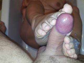 just hitting the spot with my foot on the underside of his cockhead!
