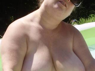 Her relaxing in the pool 4. Love those delicious tits.