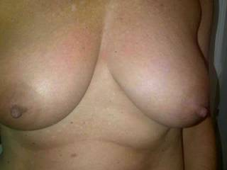 my wife's beautiful tanned breasts
