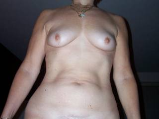 Here is my mature wife showing off her naked, built to be fucked body. Her wide hips and big mound make her able to handle anything and men just love fucking her hard and leaving her whimpering. Would you go up her wet cunt and give her a hard fucking?