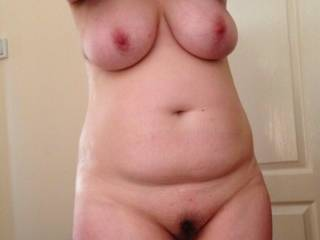 You wife has a very sexy body, great tits, lovely natural belly and a very tasty looking hairy pussy...lovely !