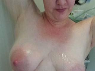 Washing her hair, heavy milk filled tits out on display