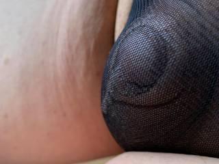 Trying on some sheer black panties.  Does he look cute?