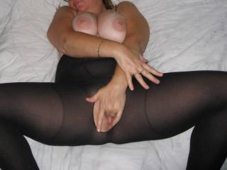 She knows with every flash it means more men looking at her, notice her smiling as she squeezes her tits and fingers that pussy
