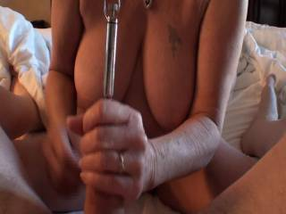 """Some Hotel fun. On the sixth floor with the curtains open. Wonder if anyone could see us? I love putting that metal rod into his dick, watching it sink 9"""" inside him, all while giving him a hand job with a happy ending. What do you think of my hand jobs?"""