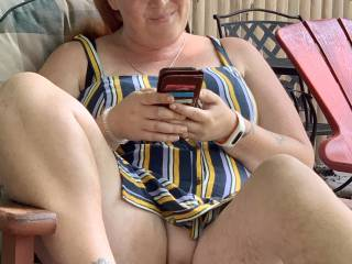 My wife flashing her pussy in the back yard.
