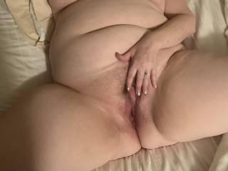 Spreading her hot legs and masturbating