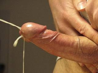 Jizz shooting out of my cock in 2 simultaneous spurts.