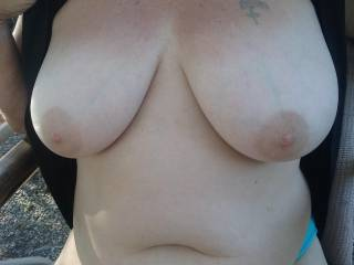 Flashing my boyfriend in the great outdoors and of course he had to snap some quick photos before we got caught. Tell me what you can say about my tits that would make me really happy, really horny, or really blush??