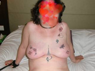 Very tightly screwed nipple rings... Sally reclining on the bed..