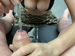 Sounding his thick cock and boy does he love it.