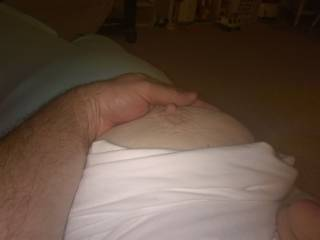 Rubbing the wife\'s tits while watching a movie.