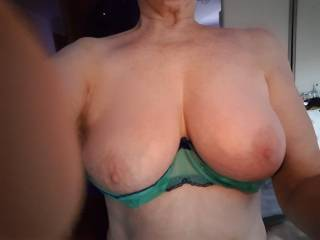Busty mature Irene shows up her big tots.