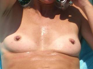 wife tanning topless again