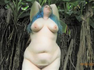 My beautiful wife showing off her big tits and her sexy chubby curves as she enjoys a naked walk out back behind our house.