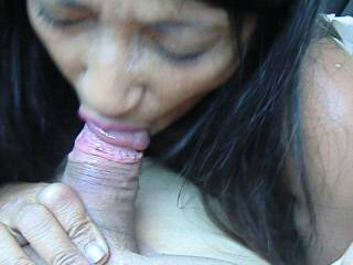She continued sucking my cock on the backseat of my car and as you can see, I filled her mouth with my cum.