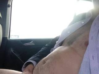 Masturbating in my car in public stripping off all my clothes while people walk past