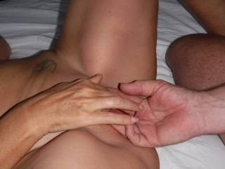 Fingering and playing with her lovely smooth pussy