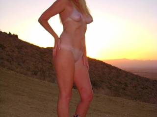 Naked sunset, now thats hot.  Nice outfit (boots).  I'd love to see you walking around in them just like you are now.  Oooooh I bet that would be hot.