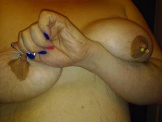 That's a girl...tug and milk those big nipples hard....like to see lots more of your stretching