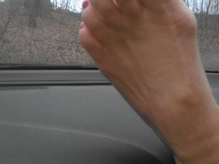 GREAT view....I couldn't be behind the wheel though. It's an rtc waiting to happen as I couldn't take my eyes off those breath takingly hot sexy toes I quite literally ache to have between my lips to suck, lick and taste....Beautiful!!