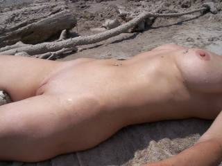 side view of whats tanning beside me