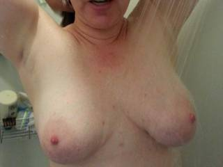 Heavy milk filled tits out in the shower