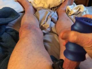 Masturbating with a vibrator around my cock and a cock sleeve.