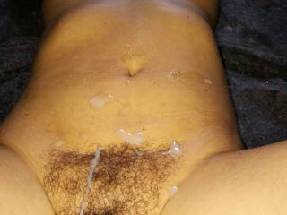 Wife\'s hairy pussy dripping with cum after a good fucking. If you enjoy this picture you should check out the video of me cumming all over her pussy. It is about 5 minutes of wonderful fun.