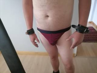 In undies with wrist and ankle cuffs - ready for session