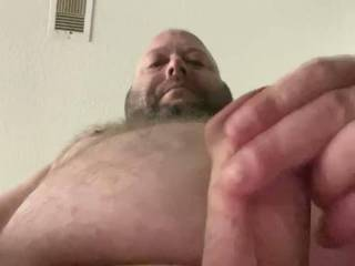 One foot on the floor, one knee on the couch, cumming over the phone