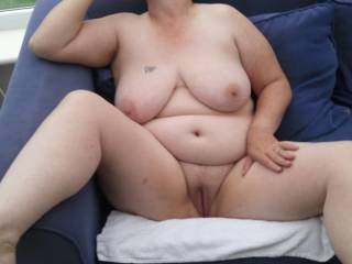 sexy pic...let me suck on your tits and tongue fuck your pussy as your smoking when your finished let me bend you over and service your fanny with my cock
