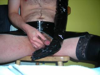 Just after wanking in PVC and cumming into a PVC glove. Now who is going to lick it clean?