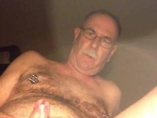 I was playing with my nipple stretching I got a hard on and had to masturbate,