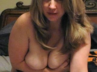 Holding those sweet tits